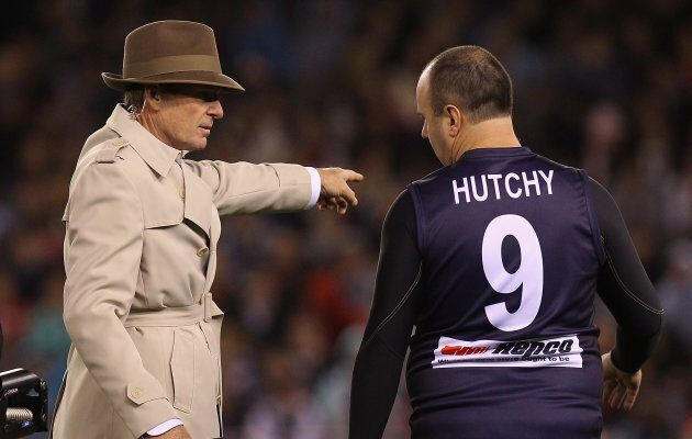 This image of Sam Newman showing Craig Hutchison where to go in a the 2011 E.J Whitten Legends Game is...