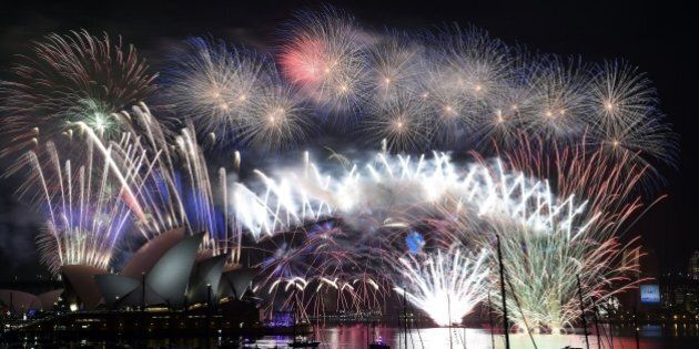New Year's fireworks erupt over Sydney's iconic Harbour Bridge and Opera House during the traditional...