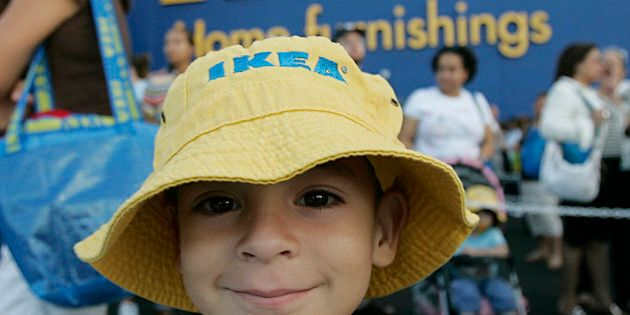 Pablo Bermudez, 5, waits in line for the Ikea Store in Sunrise, Fla. to open its doors Wednesday, Oct....