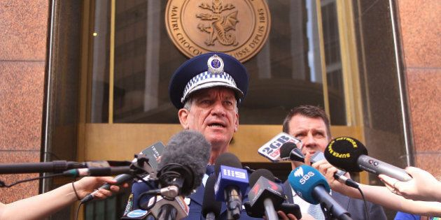 SYDNEY, AUSTRALIA - DECEMBER 15: NSW Police Commissioner Andrew Scipione talks to the media outside the...