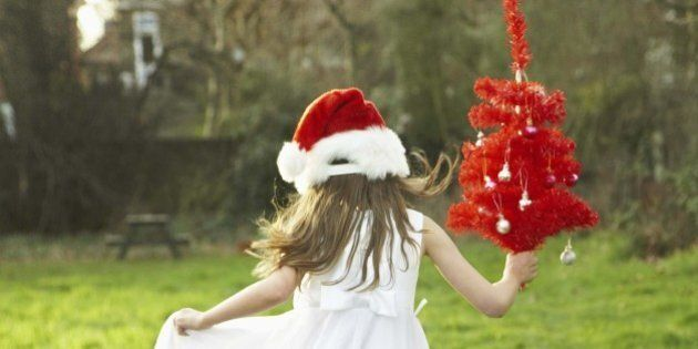 Girl dancing in field with Christmas