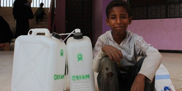 10-year-old Noran with Oxfam hygiene kits as part of a cholera response in