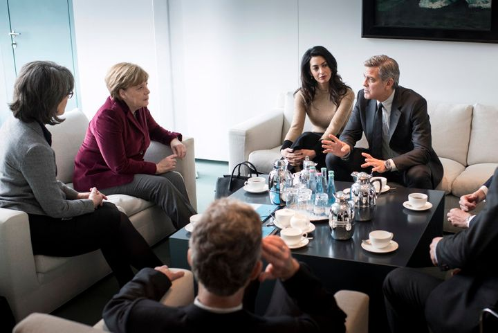 German Chancellor Angela Merkel meets with George Clooney and Amal Clooney at the Federal Chancellery to talk about refugee policy on February 12, 2016 in Berlin, Germany
