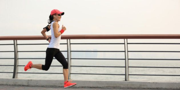 young fitness woman runner running at