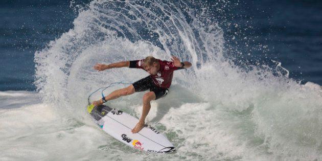 Hawaiian surfer Mick Fanning competes in the 2015 Oi Rio Pro World Surf League competition at Barra da Tijuca beach in Rio de Janeiro, Brazil, Tuesday, May 12, 2015. (AP Photo/Leo Correa)
