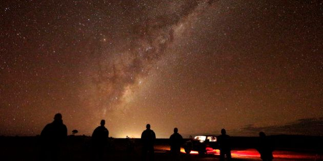 In this May 28, 2013 photo, tourists stand and gaze at the milky-way near Broken Hill, 1,160 kilometers...