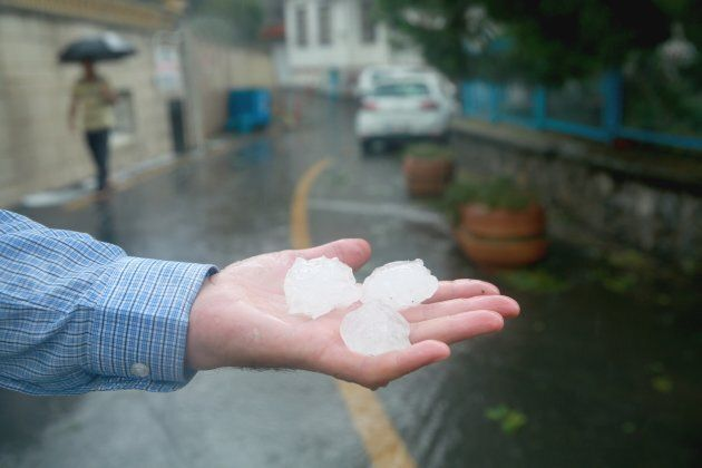 Hail the size of golf balls damaged the aircraft's windscreen.