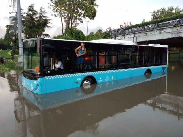 A public bus trapped on a flooded road in