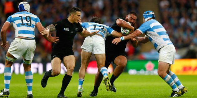 LONDON, ENGLAND - SEPTEMBER 20: Charlie Faumuina of the New Zealand All Blacksis tackled by Marcelo Bosch...
