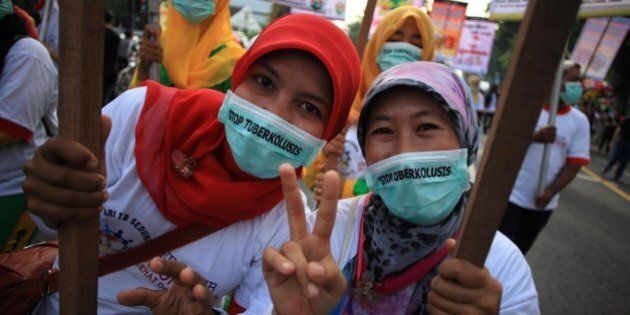 SURAKARTA, INDONESIA - MARCH 22: Activists hold banners during a rally marking the World Tuberculosis...