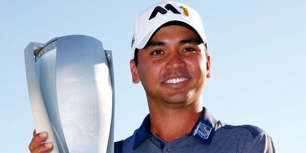 LAKE FOREST, IL - SEPTEMBER 20: Jason Day of Australia celebrates with the winner's trophy after the...
