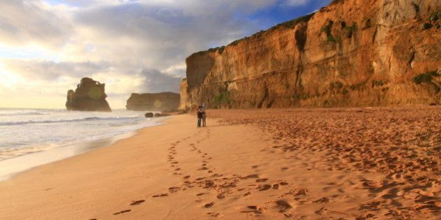[UNVERIFIED CONTENT] took in Great Ocean Road, a couple are taking photo in the beach near sunset