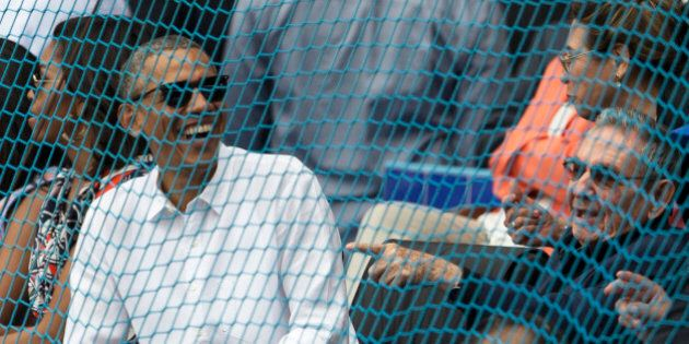 Cuban President Raul Castro, right, and U.S. President Barack Obama attend a baseball match between the...
