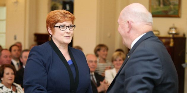CANBERRA, AUSTRALIA - SEPTEMBER 21: Minister for Defence Marise Payne is congratulated by Governor-General...