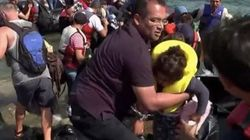Reporter Helps Refugees Come Ashore In Heartbreaking Video On