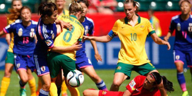 EDMONTON, AB - JUNE 27: Elise Kellond-Knight #8 defends as goalkeeper Lydia Williams #1 of Australia...