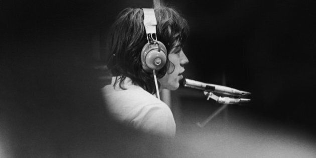 Mick Jagger of The Rolling Stones in a London recording studio during the filming of French film director...
