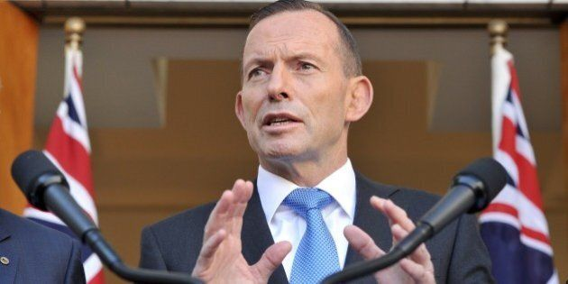 Australian Prime Minister Tony Abbott speaks to the media during a press conference at Parliament House...