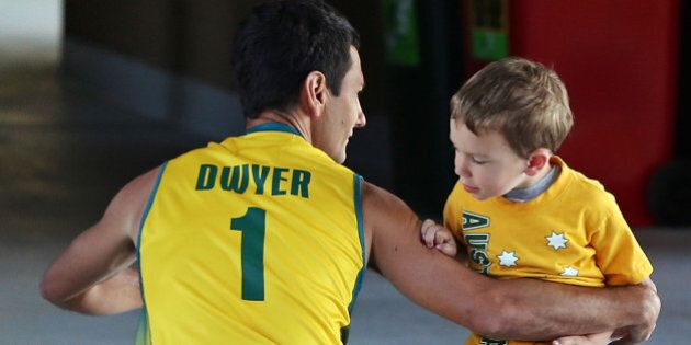 MELBOURNE, AUSTRALIA - DECEMBER 02: Jamie Dwyer of Australia says goodbye too his son Julian Dwyer before...