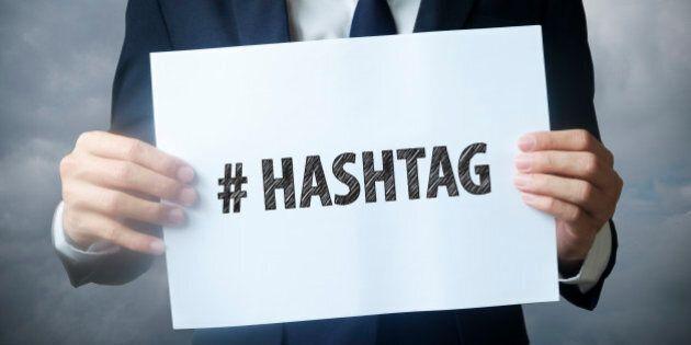 businessman hand holding  hashtag text ,business idea , business concept