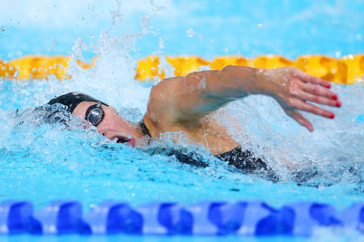 Laura competes in the Women's 4 x 100m Freestyle Relay Final at Tollcross International Swimming Centre during day one of the Glasgow 2014 Commonwealth Games on July 24, 2014 in Glasgow, Scotland.