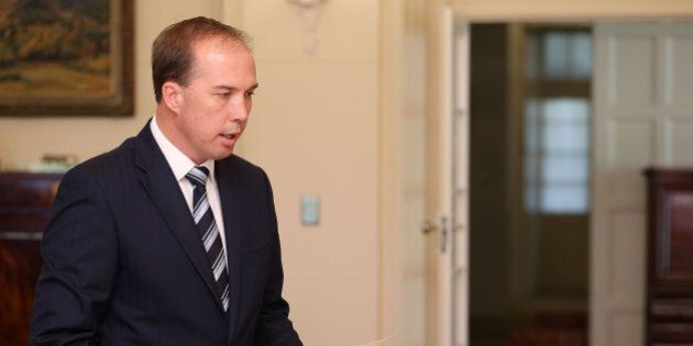 CANBERRA, AUSTRALIA - DECEMBER 23: Minister for Immigration and Border Protection Peter Dutton is sworn...