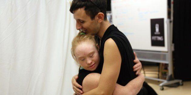 Disabled model Madeline Stuart from Brisbane, Australia hugs art director Pablo Patane during rehearsals...