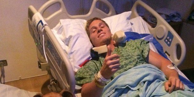 The 25-year-old's operation on his spine was a success, but he still has no movement from his chest down.