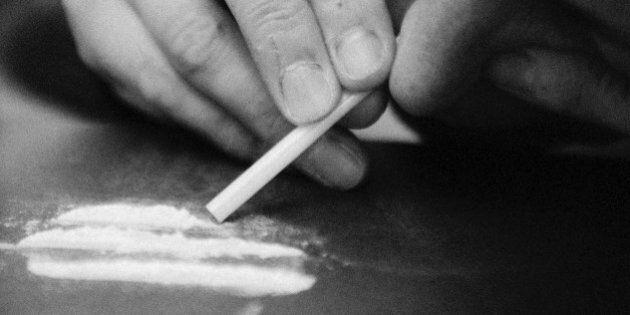 Woman taking drugs, close-up, b&w