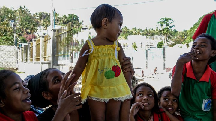 Spot the favourite. This gorgeous girl is adored by her siblings and friends. Baucau, Timor-Leste.