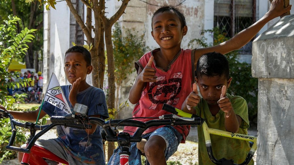 These young riders were more than comfortable striking a pose as they wait for Tour de Timor 2016 athletes to come through. Baucau, Timor-Leste.