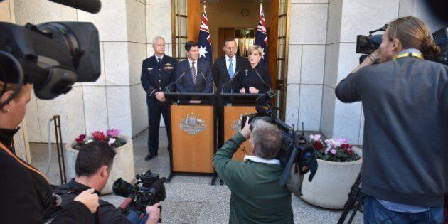 Australian Prime Minister Tony Abbott, Chief of the Australian Defence Force Mark Binskin (L), Defence...