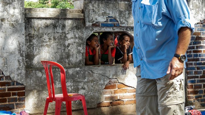 These girls peak through to see what the AUSMAT medical team get up to. Baucau, Timor-Leste.