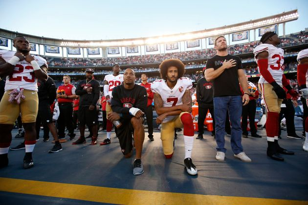 That's Kaepernick on the right on his original September 1 anthem protest, which he has since repeated...