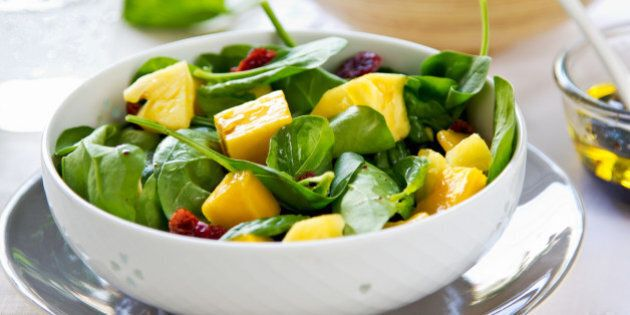 Mango and pineapple with spinach and dried cranberries