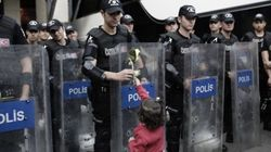 Refugee Crisis: Child Hands Flowers To Police