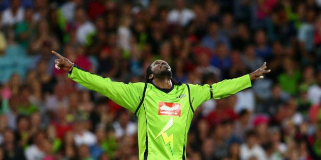 SYDNEY, AUSTRALIA - DECEMBER 30:  Chris Gayle of the Thunder celebrates taking the wicket of Moises Henriques of the Sixers during the Big Bash League match between Sydney Thunder and the Sydney Sixers at ANZ Stadium on December 30, 2012 in Sydney, Australia.  (Photo by Mark Kolbe/Getty Images)