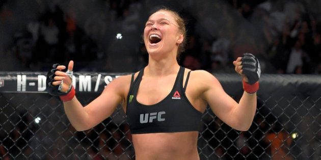 Ronda Rousey, celebrates after defeating Cat Zingano in a UFC 184 mixed martial arts bantamweight title...