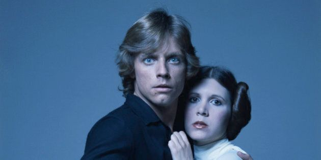 American actors Mark Hamill and Carrie Fisher in costume as brother and sister Luke Skywalker and Princess...