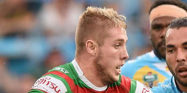 GOLD COAST, AUSTRALIA - MAY 30: Aaron Gray of the Rabbitohs takes on the defence during the round 12...