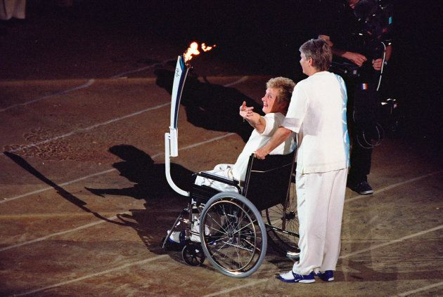 She was wheeled out by fellow Olympic sprinter Raelene Boyle at the Opening