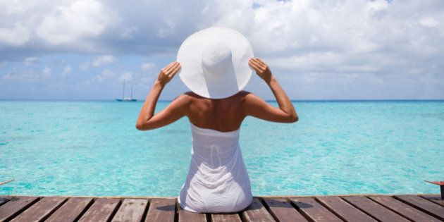 healthy tan elegant woman in white relaxing on tropical summer vacation in Tahiti, French
