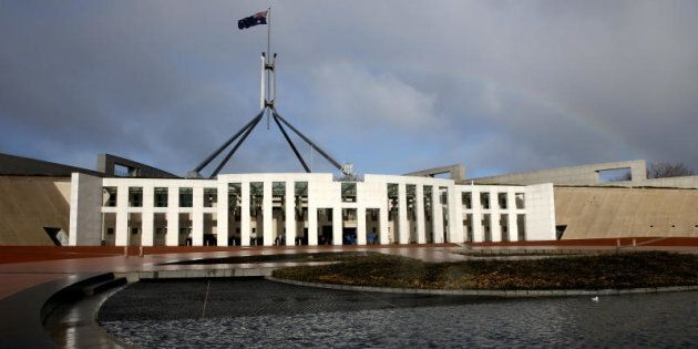 I's time. A rainbow forms over Parliament House in