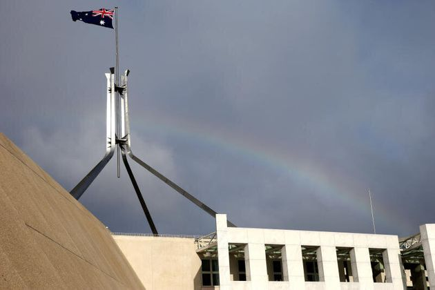 A rainbow flies over Parliament House in