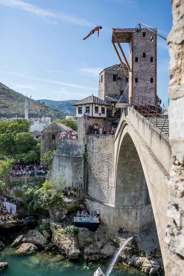 Michal Navratil from Czech Republic cliff diving from the picturesque Stari Most bridge in Mostar, Bosnia...