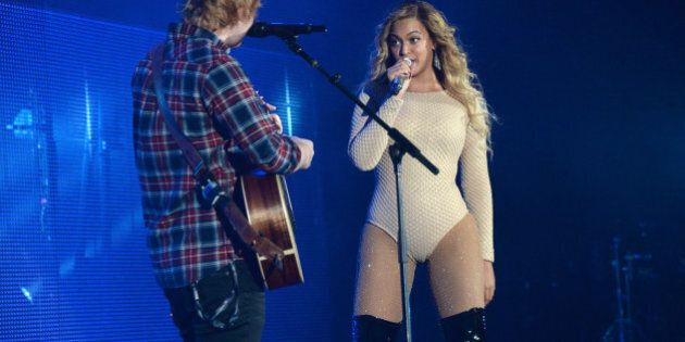 NEW YORK, NY - SEPTEMBER 26: Ed Sheeran and Beyonce perform onstage during 2015 Global Citizen Festival...