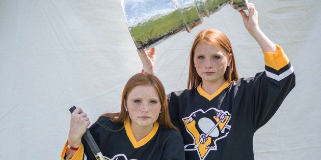 Arnette(left) and Anette Averyhave their picture taken at the Twinsburg Twins Days Festival on Aug. 4.