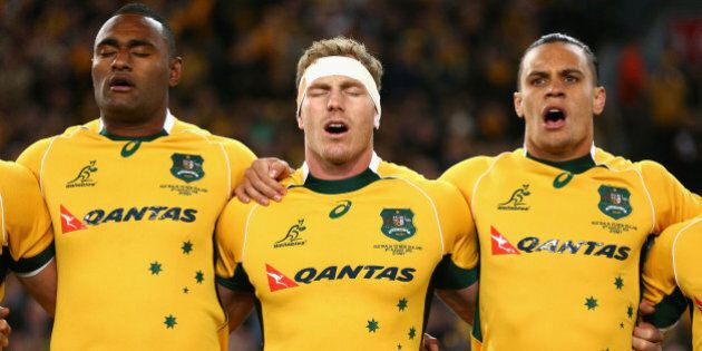 SYDNEY, AUSTRALIA - AUGUST 08: (L-R) Tevita Kuridrani, David Pocock and Matt Toomua of the Wallabies sing the Australian national anthem during The Rugby Championship match between the Australia Wallabies and the New Zealand All Blacks at ANZ Stadium on August 8, 2015 in Sydney, Australia. (Photo by Cameron Spencer/Getty Images)