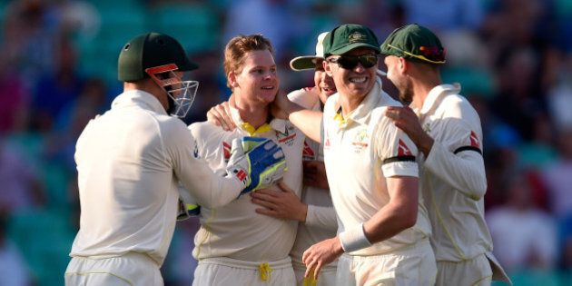 LONDON, ENGLAND - AUGUST 22: Australia bowler Steve Smith (2nd left) is congratulated after dismissing England batsman Alastair Cook for 85 runs during day three of the 5th Investec Ashes Test match between England and Australia at The Kia Oval on August 22, 2015 in London, United Kingdom. (Photo by Stu Forster/Getty Images)