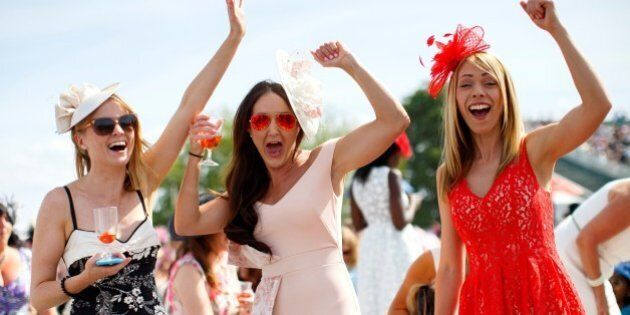 ASCOT, UK. 18 JUNE: Racegoers celebrating after winning a bet on a race on Ladies Day of Royal Ascot...